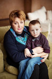 Lovely little boy with his grandmother Royalty Free Stock Photos