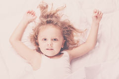 Lovely little boy lying in bed Stock Images