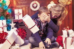 Lovely little boy opens christmas gifts Royalty Free Stock Photography