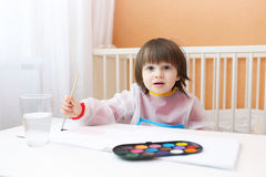 Lovely little boy painting with water color paints at home Royalty Free Stock Photo