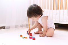 Lovely little boy with paints at home Stock Image