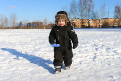 Lovely little boy with shovel in winter Stock Photography