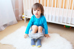 Lovely little boy sitting on potty at home Royalty Free Stock Photography