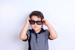 Lovely little boy in sunglasses, studio shoot on white. Children royalty free stock photos