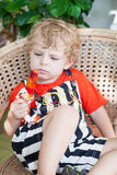Lovely little child eating colorful ice cream Royalty Free Stock Photos