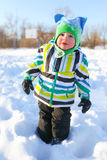 Lovely little child walking in winter outdoors Stock Images