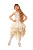 Lovely little girl in a beige dress Stock Images