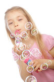 Lovely Little Girl Blowing Soap Bubbles Stock Images