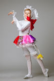 Lovely little girl dancing in colorful costume Royalty Free Stock Image