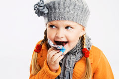 Lovely little girl eating a candy Stock Photo