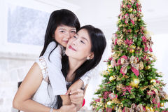Lovely little girl embrace her mother Royalty Free Stock Image
