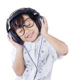 Lovely little girl enjoy mp3 with headphones Stock Image