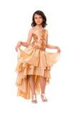 Lovely little girl in a evening dress Stock Image
