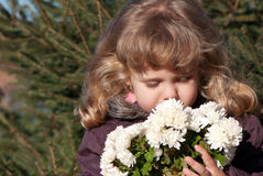 Lovely little girl with flower Stock Photos