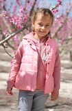 Lovely little girl in a grove of fruit trees. Spain. Lovely little girl in a grove of fruit trees in Cieza in the Murcia region. Peach, plum and nectarine trees royalty free stock photo