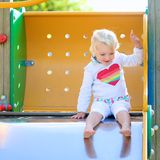 Lovely little girl having fun at playground Stock Photo
