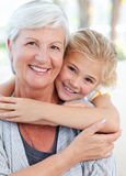 Lovely little girl with her grandmother. Looking at the camera Royalty Free Stock Photography