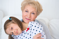 Lovely little girl with her grandmother Royalty Free Stock Photos