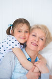 Lovely little girl with her grandmother Stock Images