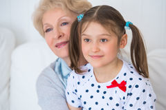 Lovely little girl with her grandmother having fun Stock Image