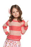 Lovely little girl holds her thumb up Stock Image