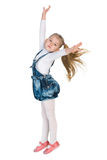 Lovely little girl jumps. A lovely little girl jumps against the white background royalty free stock photo