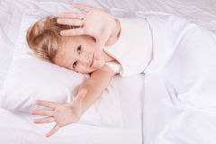 Lovely little girl lying in bed Royalty Free Stock Photo