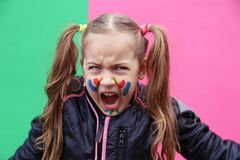 Lovely little girl making funny face stock images