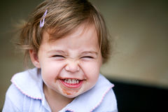 Lovely little girl making funny face Royalty Free Stock Image