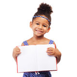 Lovely little girl with a notebook Stock Photo