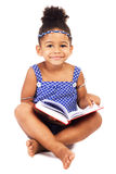 Lovely little girl with notebook. Sitting on white background Stock Image