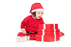 Lovely little girl opening the Christmas presents Royalty Free Stock Photos