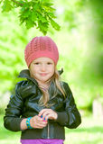 Lovely little girl in park Royalty Free Stock Photos