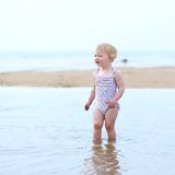 Lovely little girl playing on the beach Stock Photography