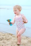 Lovely little girl playing on the beach Royalty Free Stock Photos