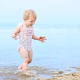 Lovely little girl playing on the beach Royalty Free Stock Images