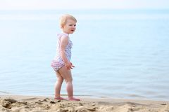 Lovely little girl playing on the beach Stock Photo
