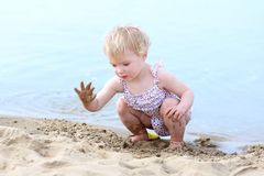 Lovely little girl playing on the beach Royalty Free Stock Photo