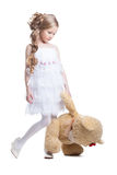 Lovely little girl with plush toy stock image