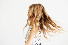 Lovely little girl in a polka-dot dress against a white backgrou Royalty Free Stock Images