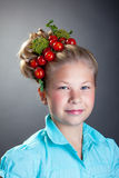 Lovely little girl posing with wreath of tomatoes Royalty Free Stock Photo