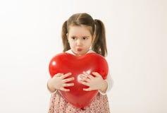 Lovely little girl pretending to be sad Royalty Free Stock Image