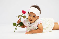 Lovely little girl with a rose Stock Photos