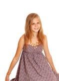 Lovely little girl sitting on floor. Stock Photos