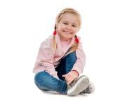 Lovely little girl sitting on the floor Royalty Free Stock Photo
