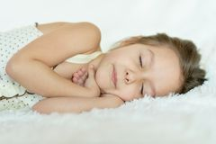 Lovely little girl. Sleeping in bed at home royalty free stock photography