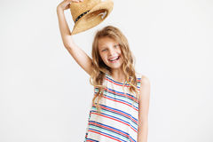 Lovely little girl with straw hat against a white background Stock Image