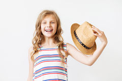 Lovely little girl with straw hat Stock Photos