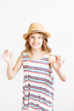 Lovely little girl with straw hat against a white background Stock Photo