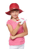 Lovely little girl wearing tourist hat holding small airplane toy Stock Photo